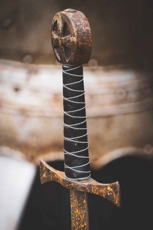 closeup photo of black hilt and brown sword